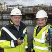 LtoR: Mark Quinn, managing director, EMR, Robbie Scott, UK & Ireland Channel Account Manager, Motorola. Picture: Maura Hickey.